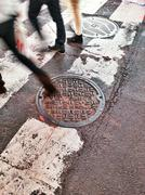 USA, New York City, Manhattan, Times Square, People stepping on manhole cover Kuvituskuvat