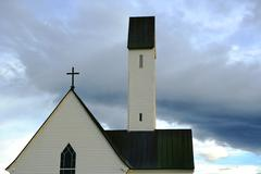 Iceland, Top section of church against moody sky - stock photo