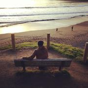 USA, California, Marin, Muir Beach, Owl Trail, Man sitting on bench during Stock Photos