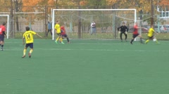 Unknowns athletes in red and yellow uniform are playing football - stock footage