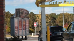 Customers in Vehicles Place Order at McDonald's Drive Thru  - stock footage