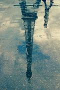 France, Paris, Reflection of Eiffel Tower in the puddle Stock Photos
