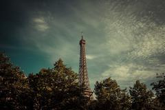 France, Paris, Eiffel Tower over treetops Stock Photos