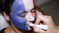 Woman face painting flag of France Stock Footage