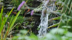 Slow motion small waterfall in country stream 96fps  pullout Stock Footage