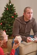 Man playing computer game at Christmas Stock Photos