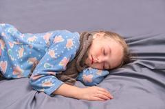 sick girl is sleeping - stock photo