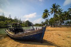 Malaysia, Terengganu, View of abandoned fishing boat near Marang - stock photo