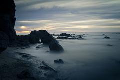 Australia, Victoria, Melbourne, Frankston, Ocean rocks at sunset Stock Photos
