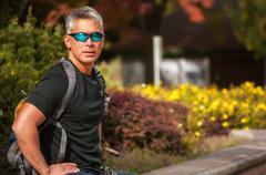USA, Idaho, Ada County, Boise, Portrait of athletic man wearing sunglasses Kuvituskuvat