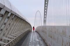 Italia, Woman in red walking down on calatrava bridge Stock Photos