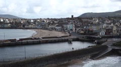 Peel on the Isle of Man a UK coastal town with a beach and harbour Stock Footage