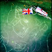UK, England, London, Chalk drawings on sidewalk and bunting next to it Stock Photos