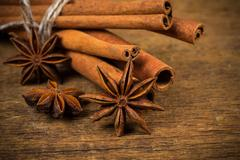 Close up of cinnamon sticks and star anise on wood Stock Photos