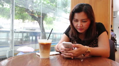 Closeup to Asian girl using app on cell phone, raining outside on street - stock footage