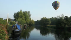 NarrowBoat On River with Balloon Flight over head Stock Footage