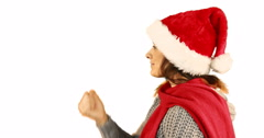 Girl in santa hat and warm clothing blowing over hands Stock Footage