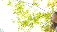 Beautiful, attractive girl swirls of autumn trees in the park Stock Footage