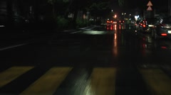 Lights reflections, asphalt. POV wet road night time driving in the city. 1080p Stock Footage