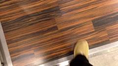 Walking on wood floor Stock Footage