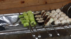 Sizzling barbecue sticks with vegetables and mushroom Stock Footage