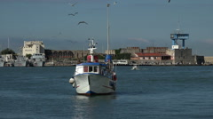 Livorno Italy fishing boat in harbor castle walls HD 015 - stock footage