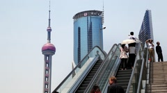People on escalator in Pudong Business District, China - stock footage