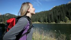Happy blond woman hiker watching mountain italian alps Stock Footage
