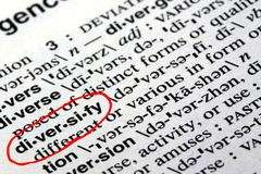 The word diversify in a dictionary - stock photo