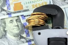 Financial Tools US Currency with Wrench Stock Photos