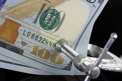 Tighten the Budget - Credit Crunch - Financial Squeeze - stock photo