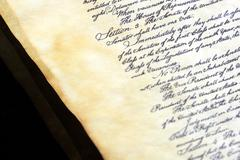 Calligraphy handwriting on old vintage paper Stock Photos