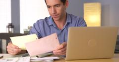 Man feeling frustrated with bills - stock photo