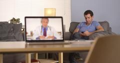 Doctor giving advice via webcam Stock Photos
