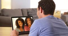 Diverse friends videochatting on laptop Stock Photos