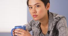 Tough Chinese woman looking at camera Stock Photos