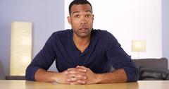 Black man talking to camera - stock photo