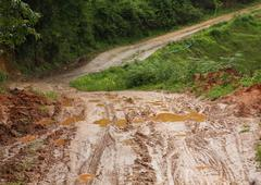 Stock Photo of road wet muddy of countryside