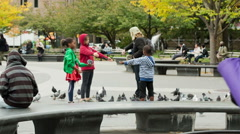 Man Teaching Children Bird Tricks Playing Pigeons Washington Square Park NYC Stock Footage