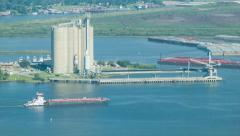 Silos and Barges in the Houston TX Shipping Channel Stock Footage
