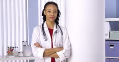 Successful African woman doctor standing in office Stock Photos