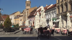 Restaurants and relaxing places for tourists in a historic square. Stock Footage