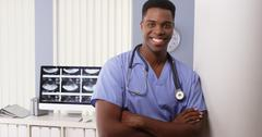 Portrait of black male medical doctor in hospital Stock Photos