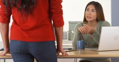 Asian manager assigning task to employee Stock Photos