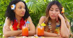 Bored African American and Asian women on vacation - stock photo