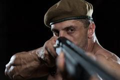 soldier drawing machine gun in self defense - stock photo
