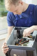 Hardware expert during his work Stock Photos