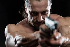 man drawing a gun in self defense - stock photo