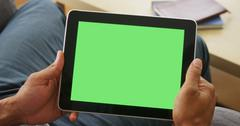 Closeup of tablet with greenscreen Kuvituskuvat