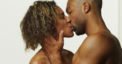 Happy black couple kissing Kuvituskuvat